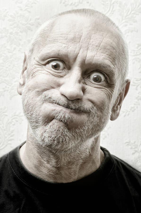 Portret van een Grappige en Gekke Mens stock foto's