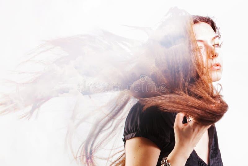 Portret van een jonge aantrekkelijke vrouw en wolken in de hemel, dubbele blootstelling Dromen en ziel, royalty-vrije stock fotografie