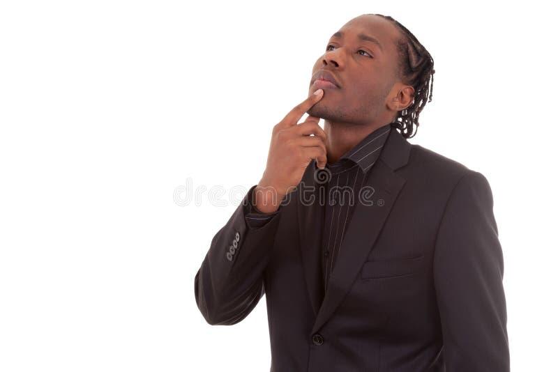 Portret van een jonge Afrikaanse amercan bedrijfsmens die - Blac denken stock fotografie