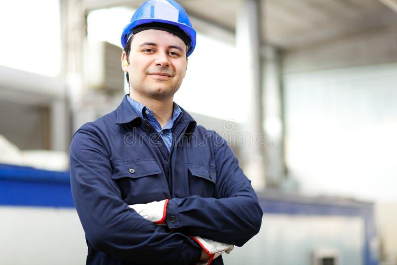 Portret van een jonge elektricien stock afbeeldingen