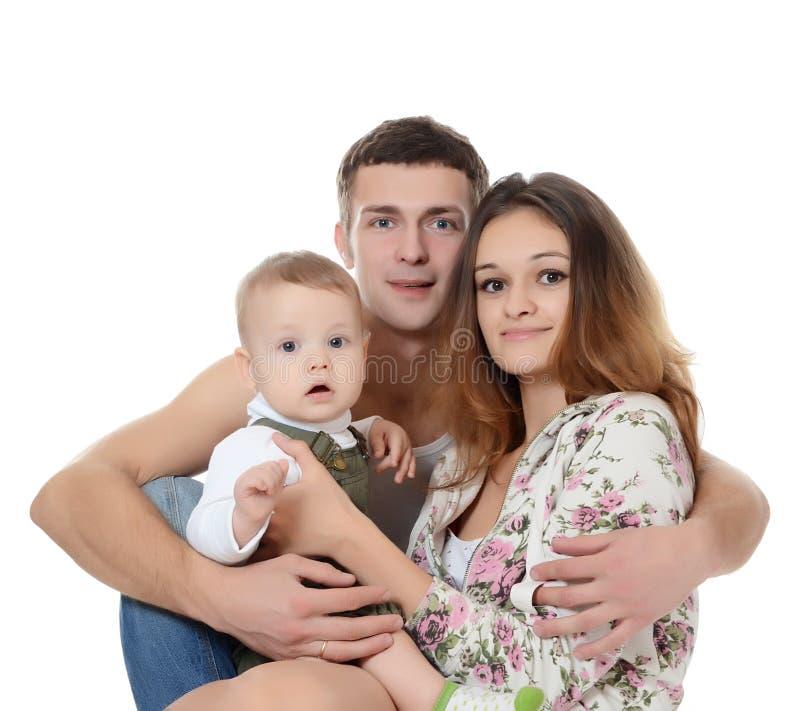 Portret van een jonge gelukkige familie met het jonge geitje stock afbeelding