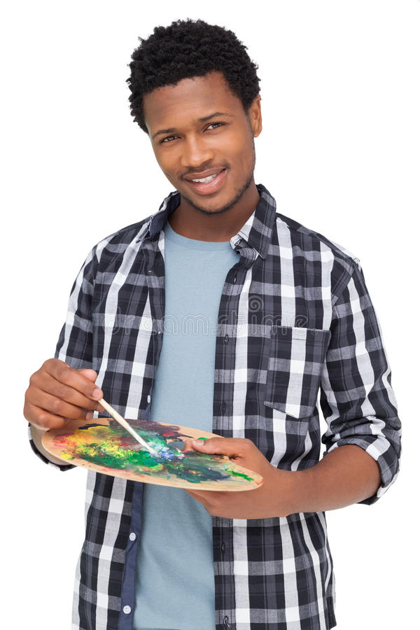 Portret van een jonge mannelijke schilder met palet stock afbeelding