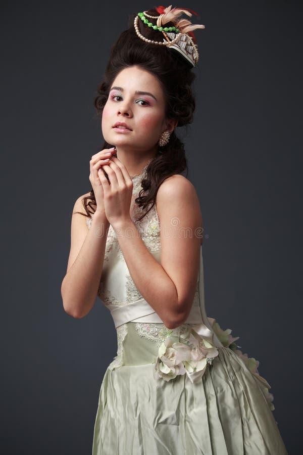 Portret van een jonge tedere vrouw in een rococo'sstijl royalty-vrije stock afbeeldingen