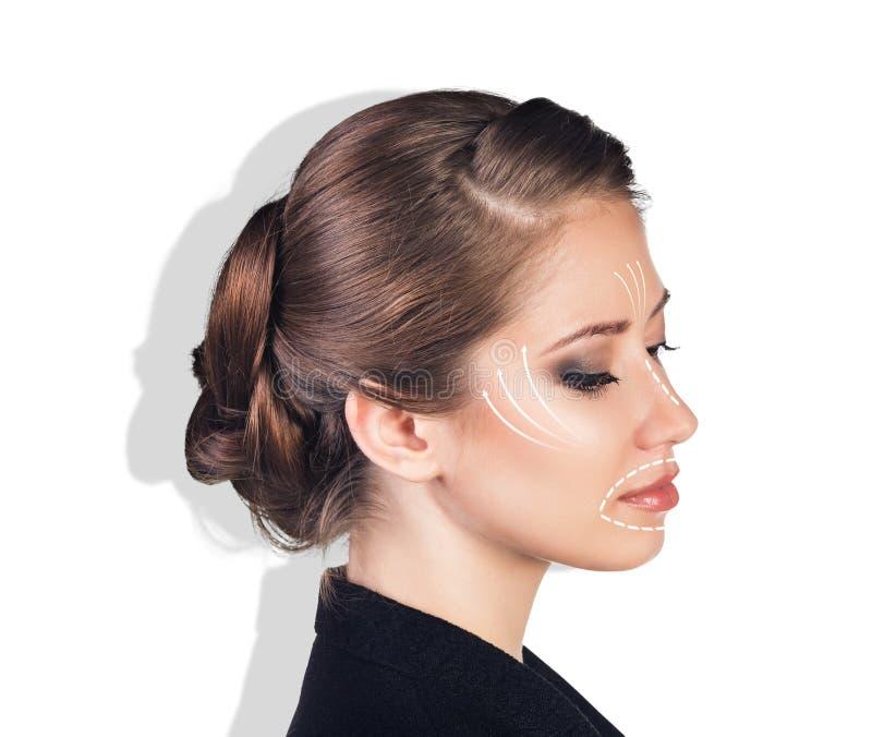 Portret van een jonge vrouw met lijnen op haar gezicht royalty-vrije stock foto