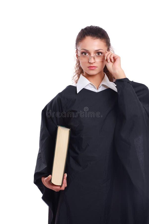 Portret van een jonge vrouwelijke die rechter, op witte achtergrond wordt geïsoleerd stock fotografie
