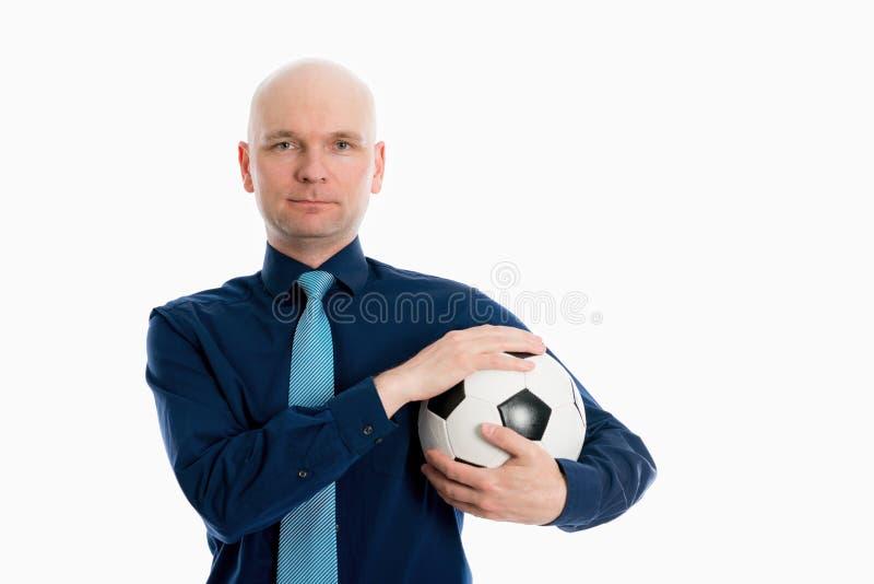 Portret van een jonge zakenman met voetbalbal stock foto's
