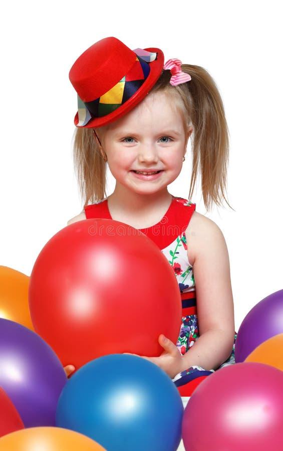 Portret van een klein meisje die met ballen spelen stock afbeeldingen