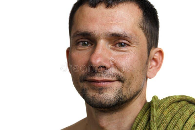 Portret van een klimmer met kabel op zijn schouder op witte achtergrond royalty-vrije stock foto