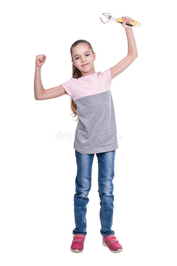 Portret van een meisje met moersleutel stock afbeeldingen