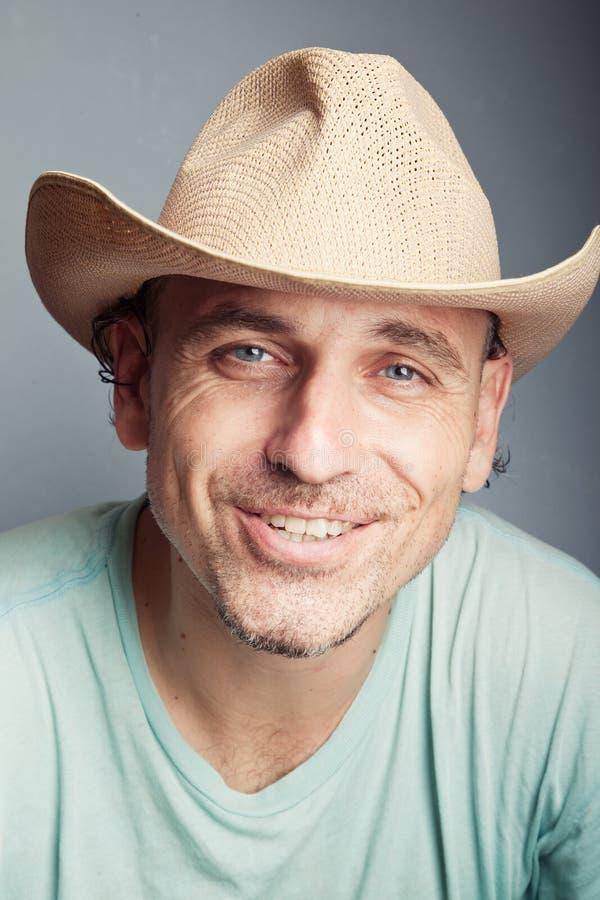 Portret van een mens in een cowboyhoed royalty-vrije stock afbeeldingen
