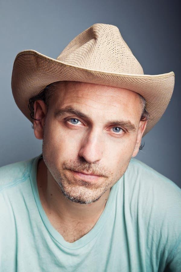 Portret van een mens in een cowboyhoed stock foto