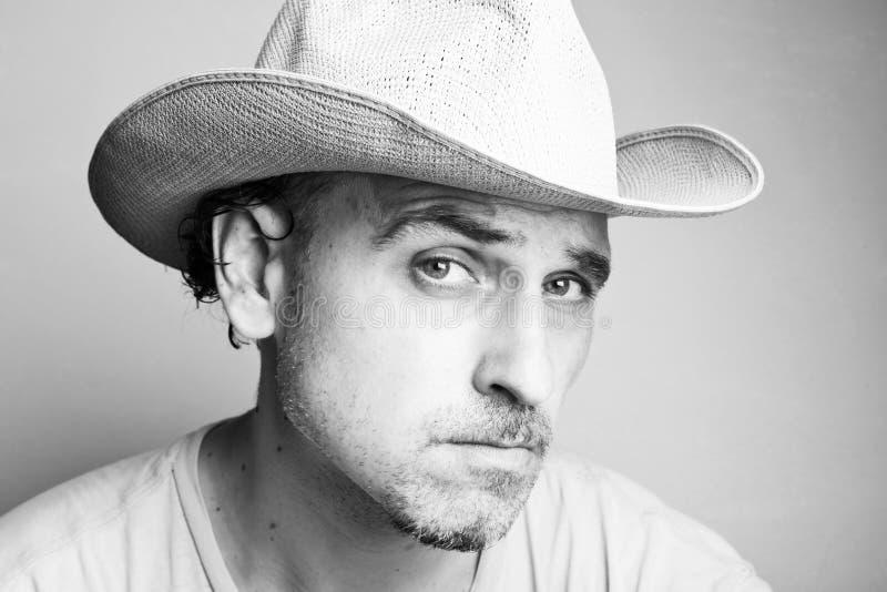 Portret van een mens in een cowboyhoed stock afbeelding