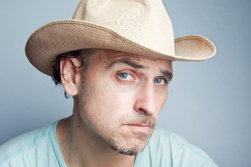Portret van een mens in een cowboyhoed stock fotografie