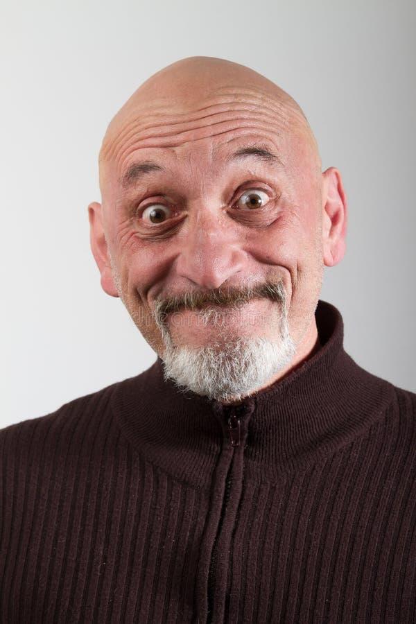 Portret van een mens met grappige gelaatsuitdrukkingen royalty-vrije stock foto's