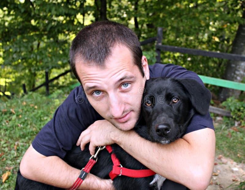 Portret van een mens met hond stock fotografie