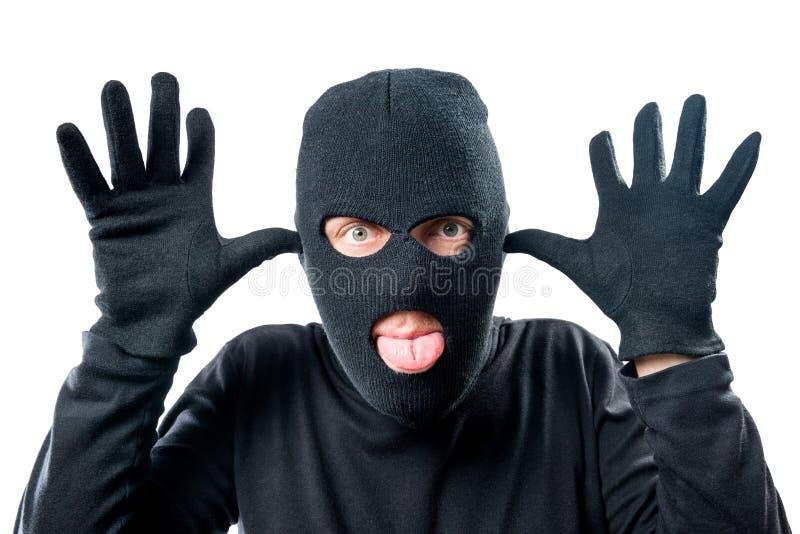 portret van een misdadige gemaskeerde vrolijke gezichtsexpressio stock foto's