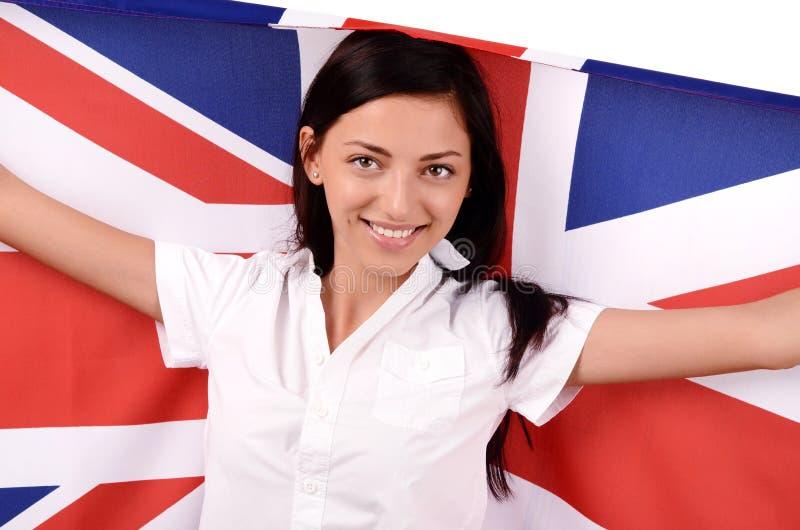 Portret van een mooi Brits meisje die steunend de Britse vlag glimlachen. stock afbeelding