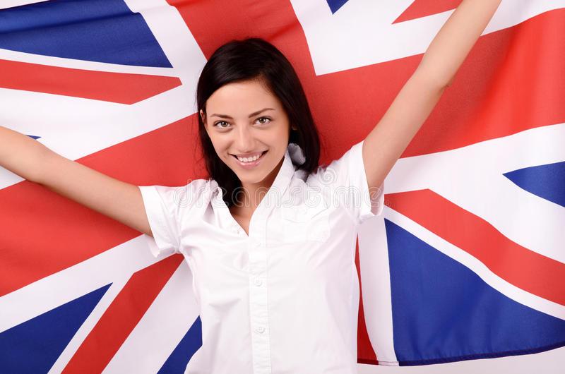 Portret van een mooi Brits meisje die steunend de Britse vlag glimlachen. royalty-vrije stock afbeeldingen