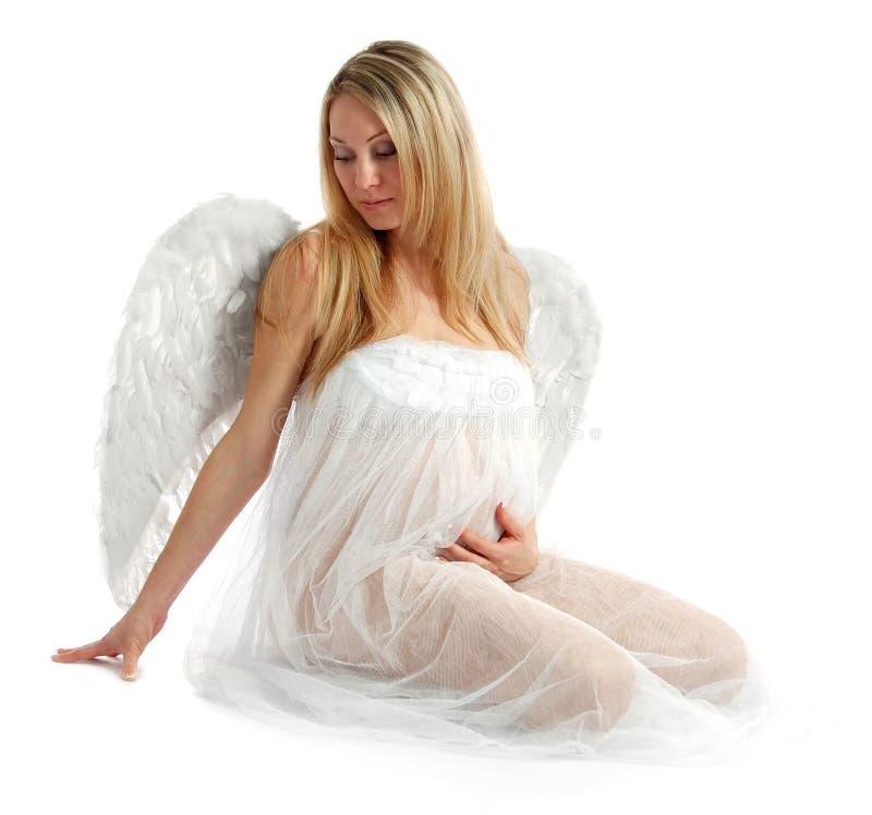 Portret van een mooie engelachtige zwangere vrouw stock afbeeldingen