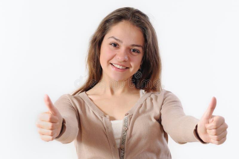 Portret van een mooie jonge vrouw die en duimenu glimlachen houden royalty-vrije stock foto
