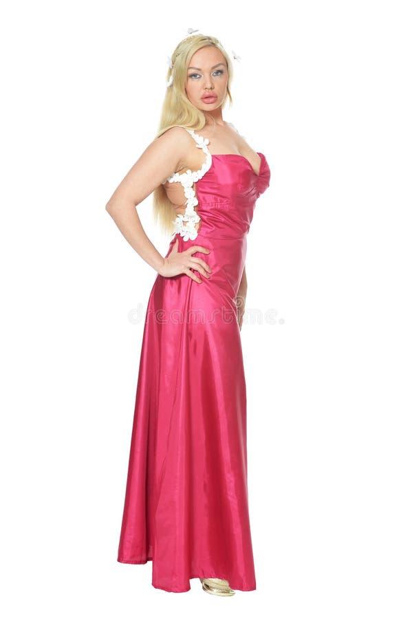 Portret van een mooie vrouw in het roze kleding stellen stock afbeelding