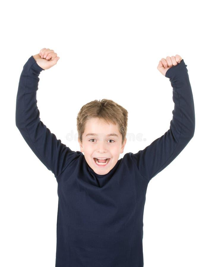 Portret van een opgewekte jonge jongen met opgeheven handen stock afbeeldingen