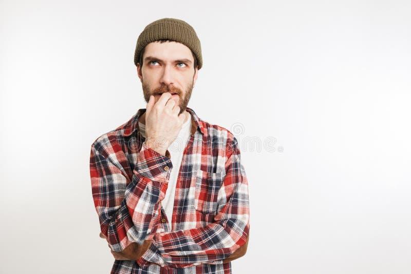 Portret van een peinzende gebaarde mens stock foto's
