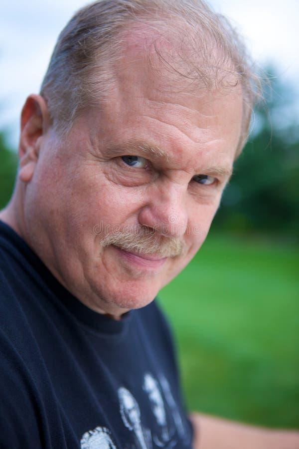 Portret van een rijpe mens stock foto's