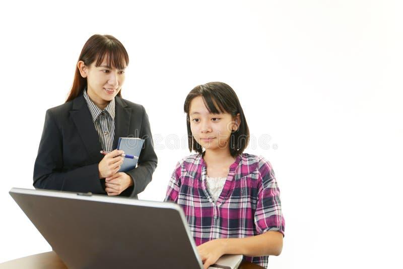 Portret van een student met een leraar royalty-vrije stock afbeelding