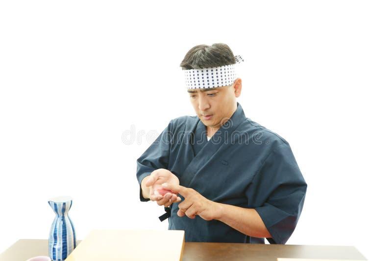 Portret van een sushichef-kok stock foto's