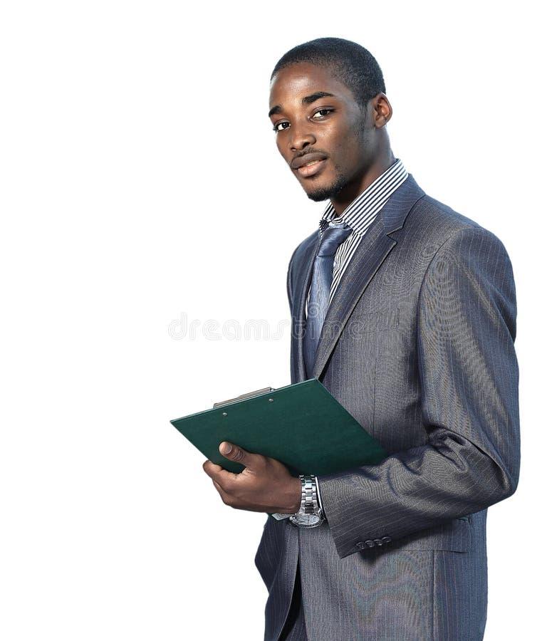 Portret van een tevreden jonge Afrikaanse Amerikaanse bedrijfsmens stock afbeelding