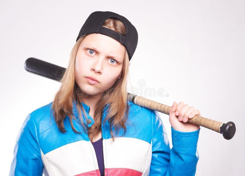 Portret van een tienermeisje met knuppel stock foto