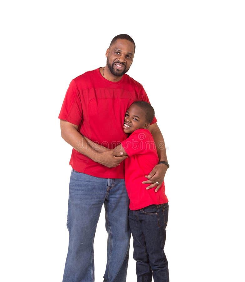 Portret van een vader en zijn school verouderde zoon stock afbeelding