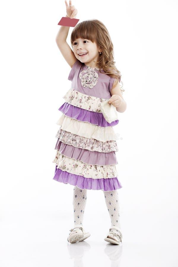 Portret van een vrolijk meisje met een zak stock afbeeldingen