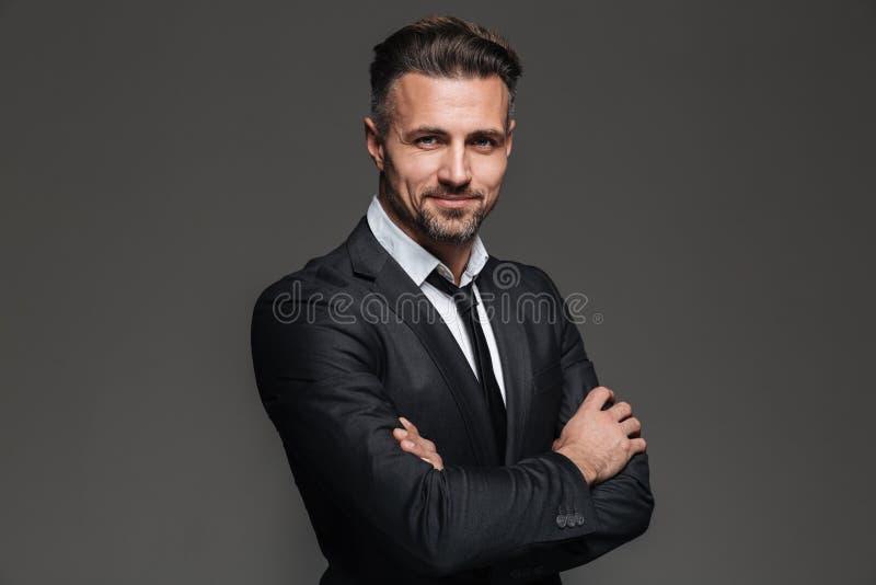 Portret van een vrolijke rijpe zakenman stock foto's
