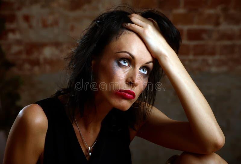 Portret van een vrouw met stromende samenstelling royalty-vrije stock foto's