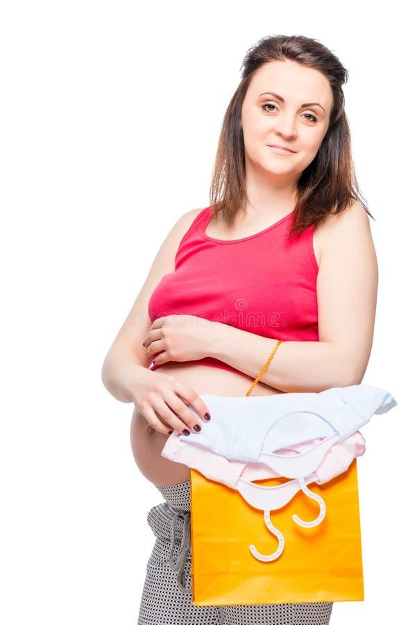Portret van een zwangere vrouw met het winkelen zakken royalty-vrije stock afbeelding