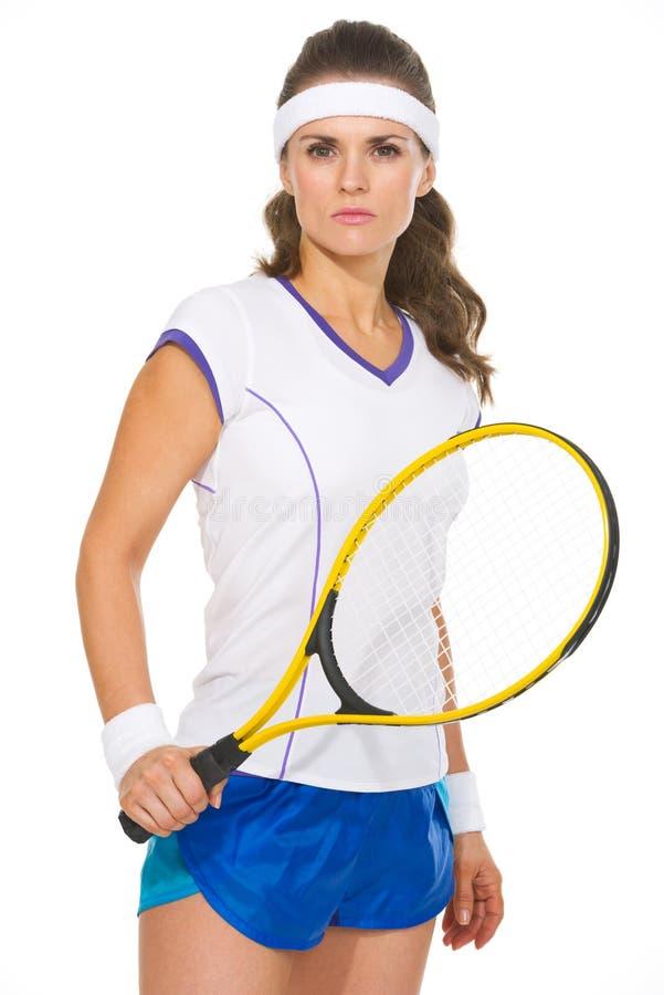 Portret van ernstige vrouwelijke tennisspeler royalty-vrije stock foto's