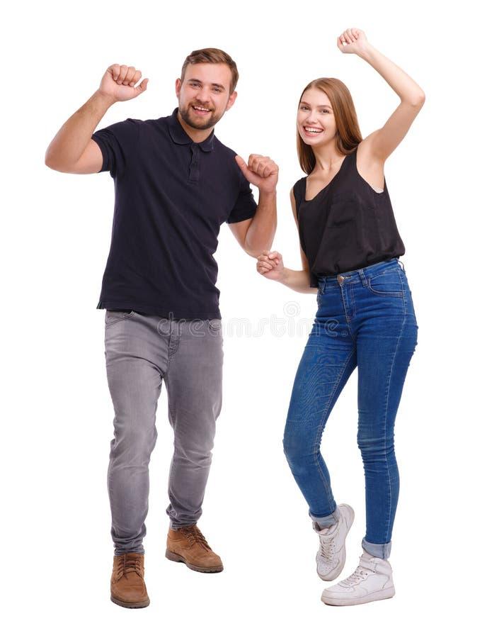 Portret van gelukkig paar die dansen die, op witte achtergrond wordt geïsoleerd stock foto's