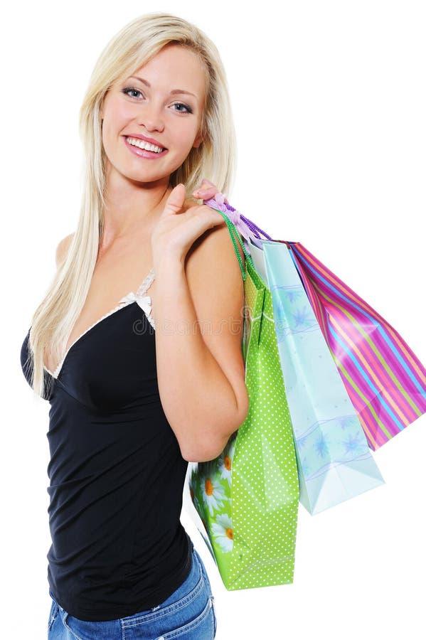 Portret van gelukkige blonde vrouw met aankopen stock fotografie