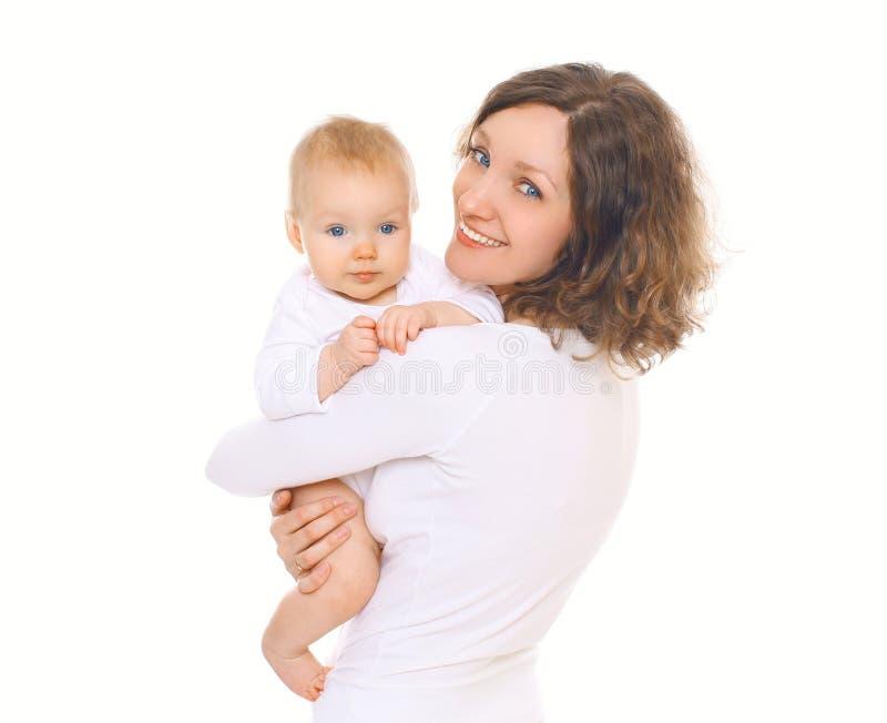 Portret van gelukkige glimlachende moeder en haar baby stock fotografie