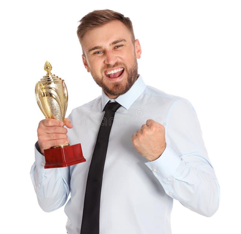 Portret van gelukkige jonge zakenman met gouden trofeekop stock foto's