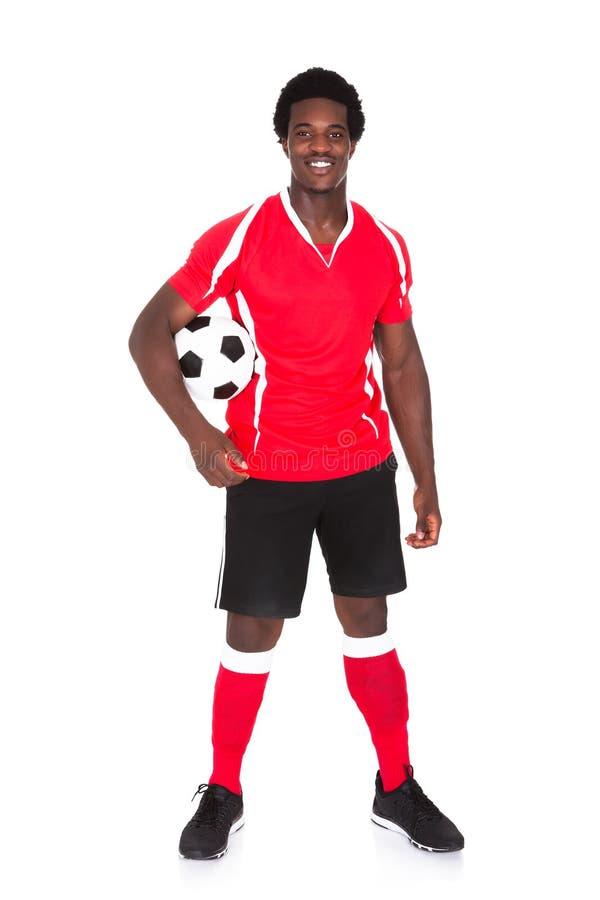Portret van gelukkige voetballer stock foto