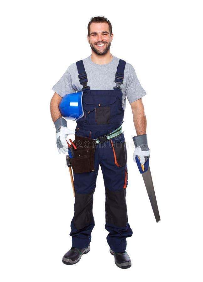 Portret van glimlachende arbeider in blauwe eenvormig royalty-vrije stock foto