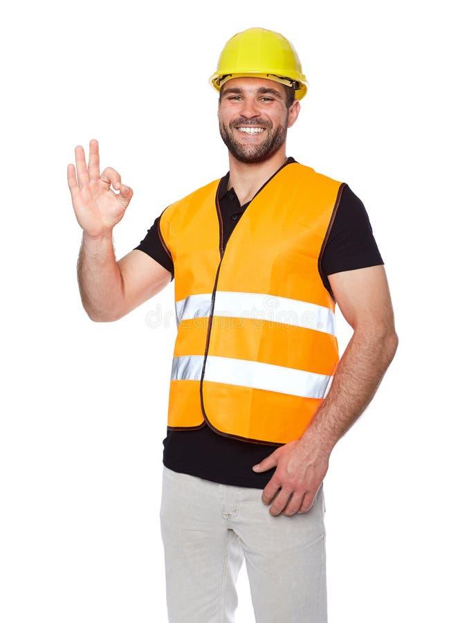 Portret van glimlachende arbeider in een weerspiegelend vest royalty-vrije stock foto's