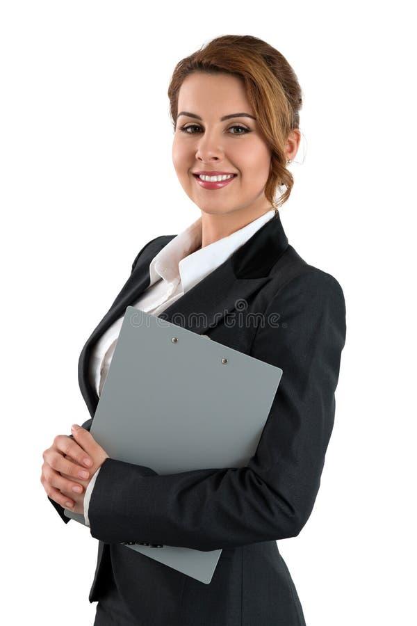 Portret van glimlachende bedrijfsvrouw die grijs het knippen stootkussen houden royalty-vrije stock fotografie