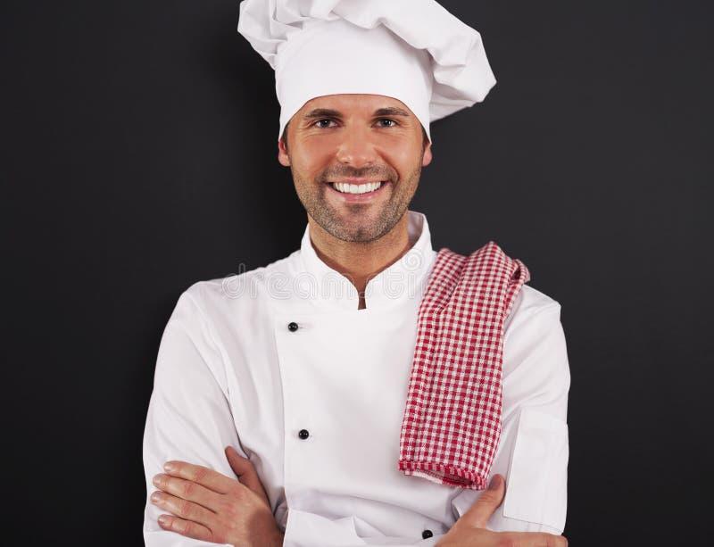 Portret van glimlachende chef-kok stock afbeelding