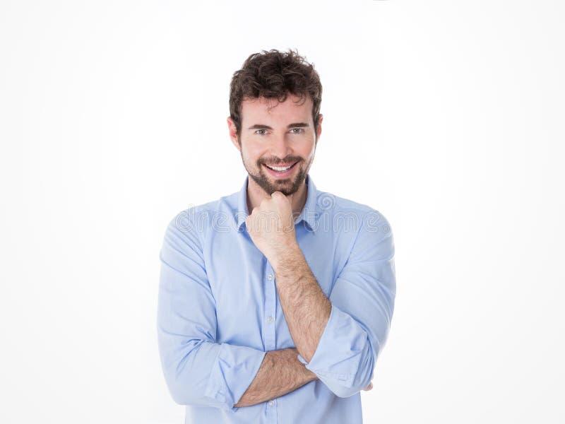 Portret van het glimlachen van knappe jonge kerel met turkoois overhemd stock foto