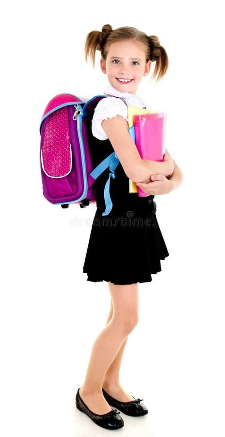 Portret van het glimlachende kind van het schoolmeisje met rugzak en boeken stock foto