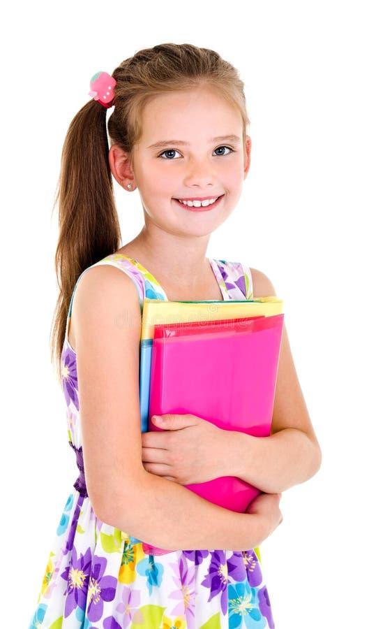 Portret van het glimlachende kind van het schoolmeisje met schooltas en boeken royalty-vrije stock afbeeldingen